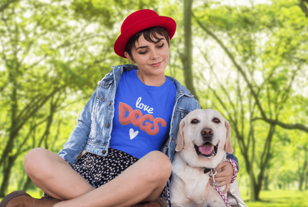 Girl wearing love dogs t-shirt with her labrador