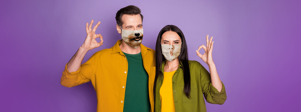 Man and woman with funny face masks