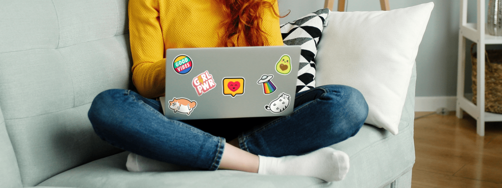 Women with cute stickers on laptop