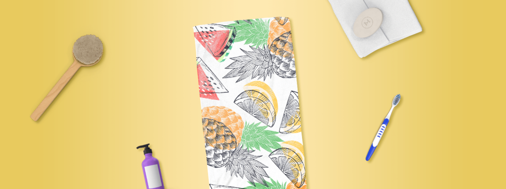 Tropical printed towel with bathroom items