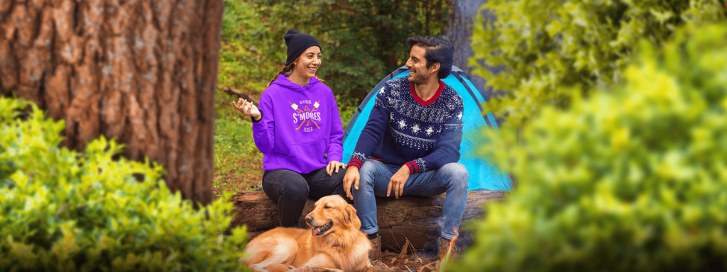 Couple camping wearing camping design hoodie