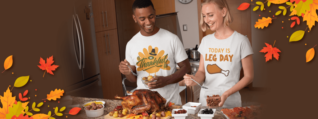Couple wearing Thanksgiving design tees while cooking turkey