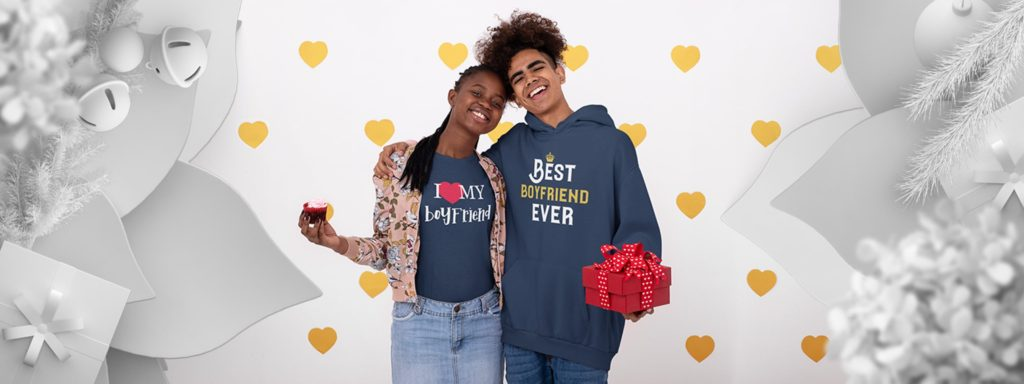 Couple exchanging Christmas gifts, wearing boyfriend and girlfriend designs gifts