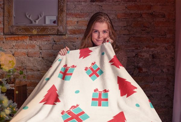 Girl Holding A Christmas Design Fleece Blanket